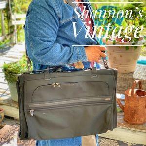 TUMI garment trifold carry on bag